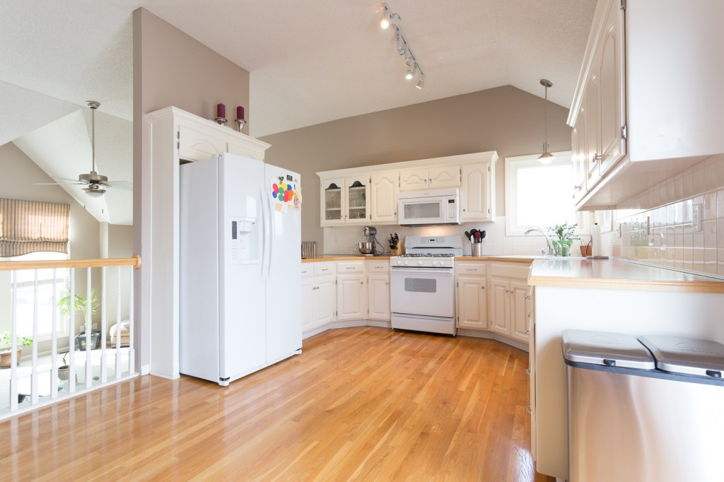 photo of a white kitchen in a split level home