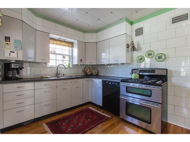 Unique Belgian Tile Kitchen & Original Cabinetry....note Ceiling